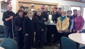 Team picture with the trophy.