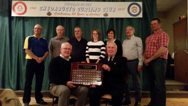 In 1963 a group of community-minded individuals had the great idea that Boylston and its surrounding region should be able to enjoy the sport of curling therefore they set about establishing a rink. To recognize the 29 individuals who have held the position of the Chedabucto Curling Club President over its 52-year history a plaque was recently purchased to display their names. That acquisition was made possible through the donations of Hope Wright, in memory of her husband Earl Wright (1967), and of Haliburton PharmaChoice / Guysborough Pharmacy (Terry Haliburton), in memory of Joseph Dort (1977). At the Past Presidents' plaque's presentation during the rink's season closing dinner and awards ceremony nine of the Chedabucto Curling Club's past presidents were in attendance. The past presidents available to receive the plaque were (front row left–right,) Angus MacIsaac  (1973) and Miles MacDonald (1978). (back row, left-right) Wayne Sangster (1995), Gerry Jamieson (1987), Danny Hart (1998, 2000-2001), Shauna Brymer (1999), Donalda Mattie (2000-2003), Ralph Mattie (2004) and Blair Brymer (2005-2007) photo: Holly Nahrebecky